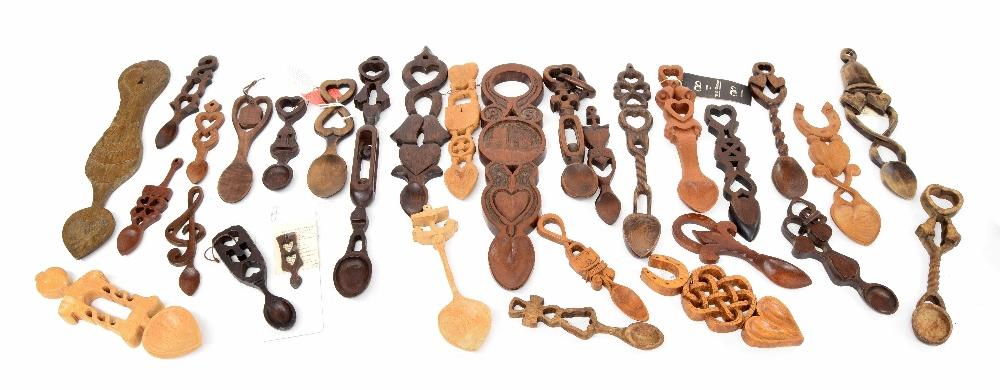Collection of thirty carved treen Welsh love spoons, together with ...