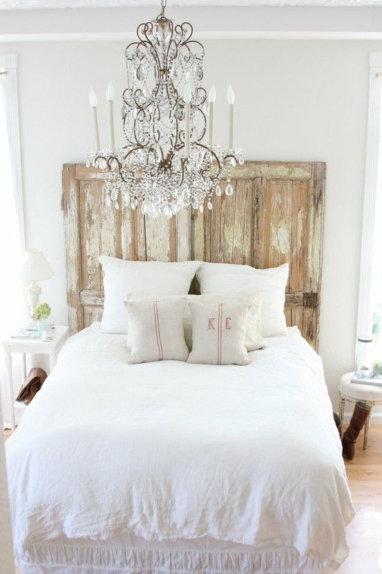 aged headboard is probably all you need to make your bedroom look chic