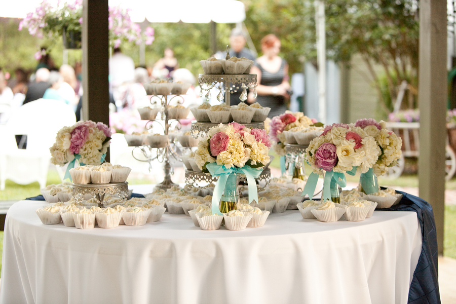 Wedding centerpiece idea spray paint gold bottles and fill with florals